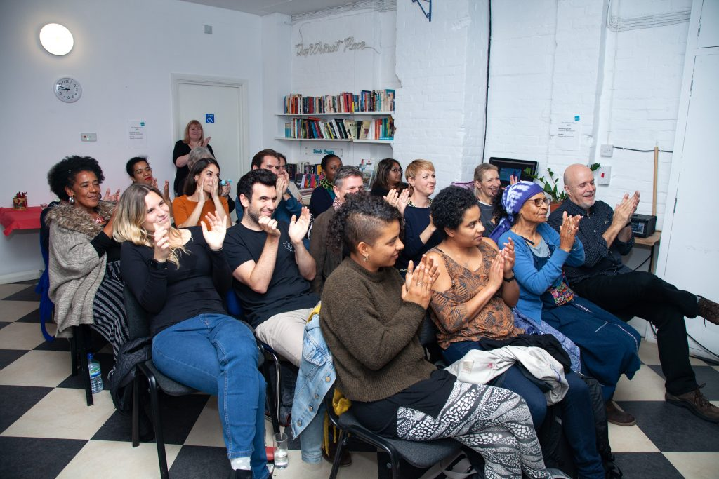 audience clapping at literature event